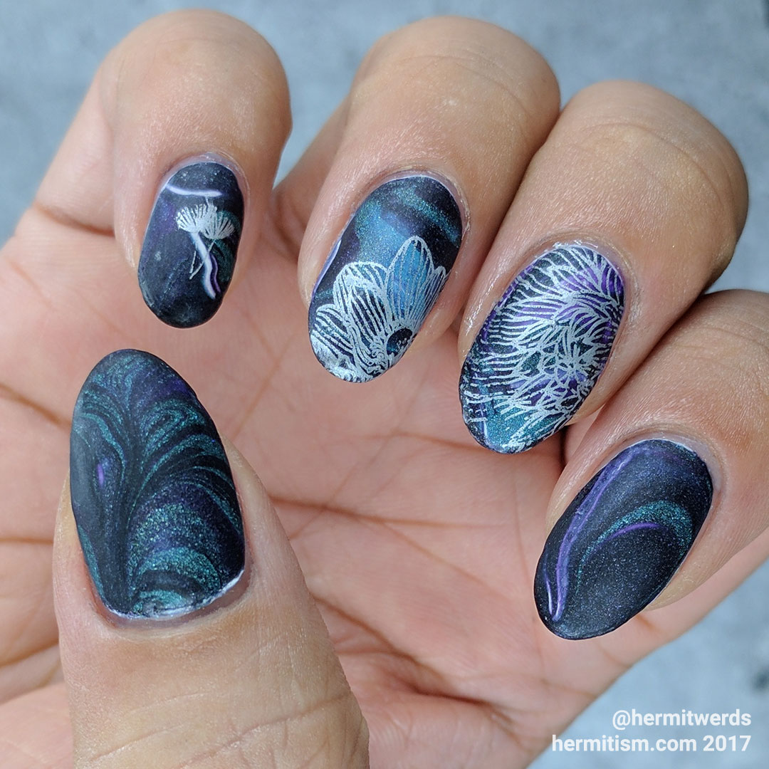 Black Heart-ed Floral - Hermit Werds - Nail art featuring Dark Heart brand nail polish (Hot Topic) in a water marble with floral stamping on top