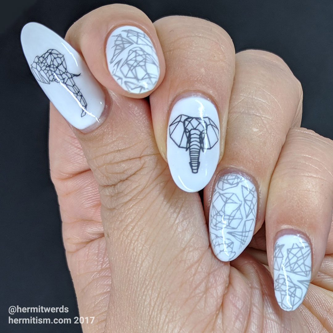 Endangered Elephant - Hermit Werds - the outlines of a geometric elephant manicure