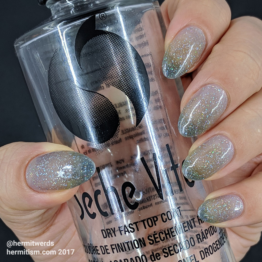 "Shinespark Polish's ""Snowfall"" with empty bottle of Seche Vite top coat"