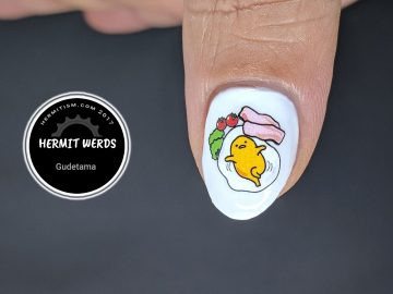 Gudetama - Hermit Werds - Sanrio's Gudetama water decals on a white background