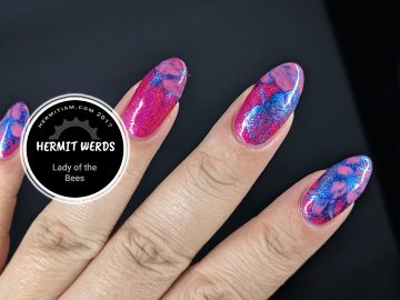 Lady of the Bees - Hermit Werds - pink holographic nails with a lady bee gathering nectar from flowers
