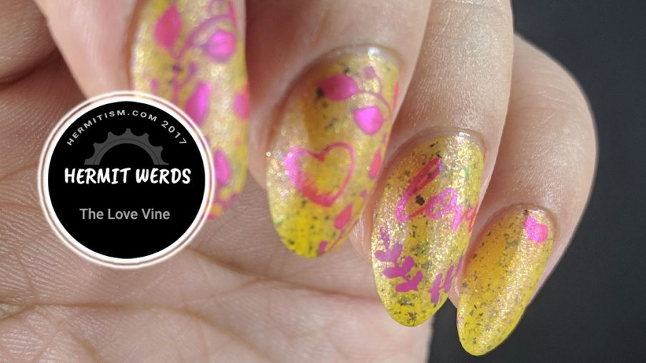 """The Love Vine - Hermit Werds - pink stampings of hearts, vines and """"love"""" on a yellow flakie background"""