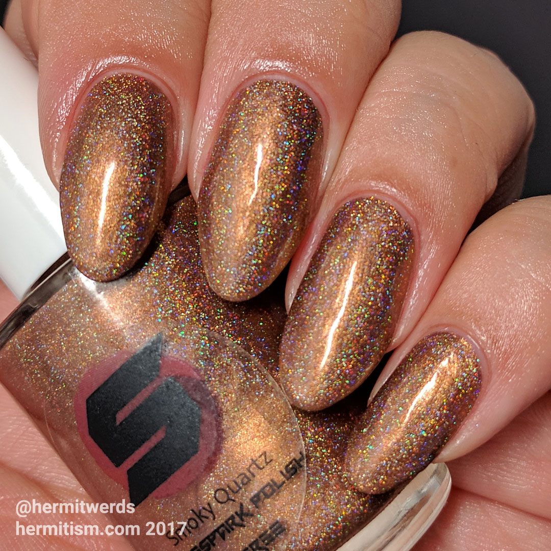 Shinespark Polish - Smoky Quartz - Hermit Werds - swatch of polish on natural nails under a natural light bulb