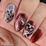 Vampiric Snacking - Hermit Werds - seductive vampiric nail art on a blood red polish