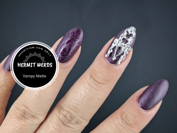 Vampy Matte - Hermit Werds - burgundy holographic matte mani with silver nail shield and glossy stamping
