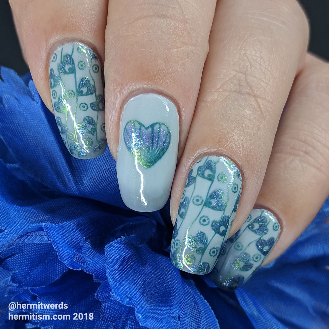Patterns of the Heart - Hermit Werds - blue and green stamping on a grey thermal background