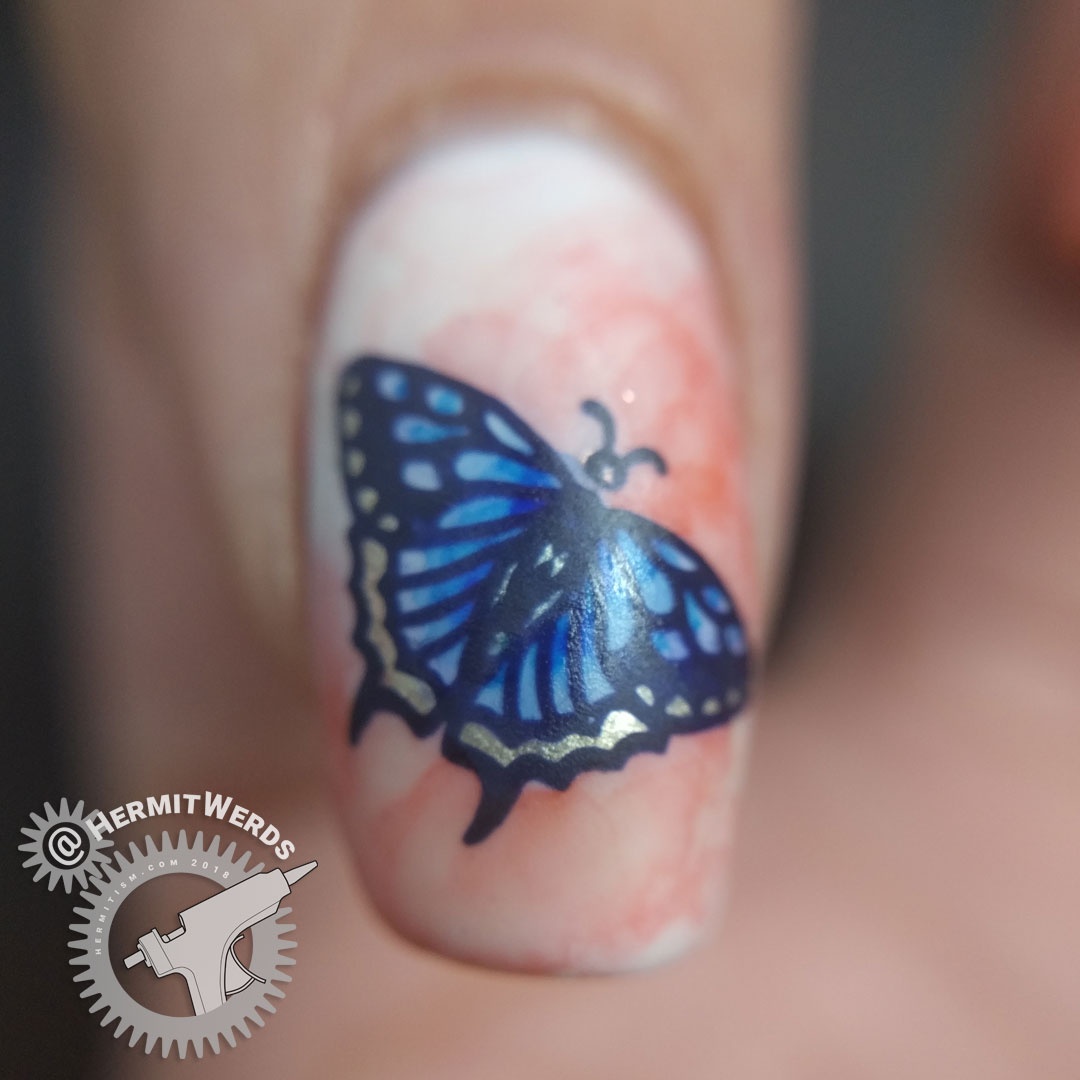 Garden Variety Butterflies - Hermit Werds - blue and orange watercolor-like nail art featuring butterflies that are half flower