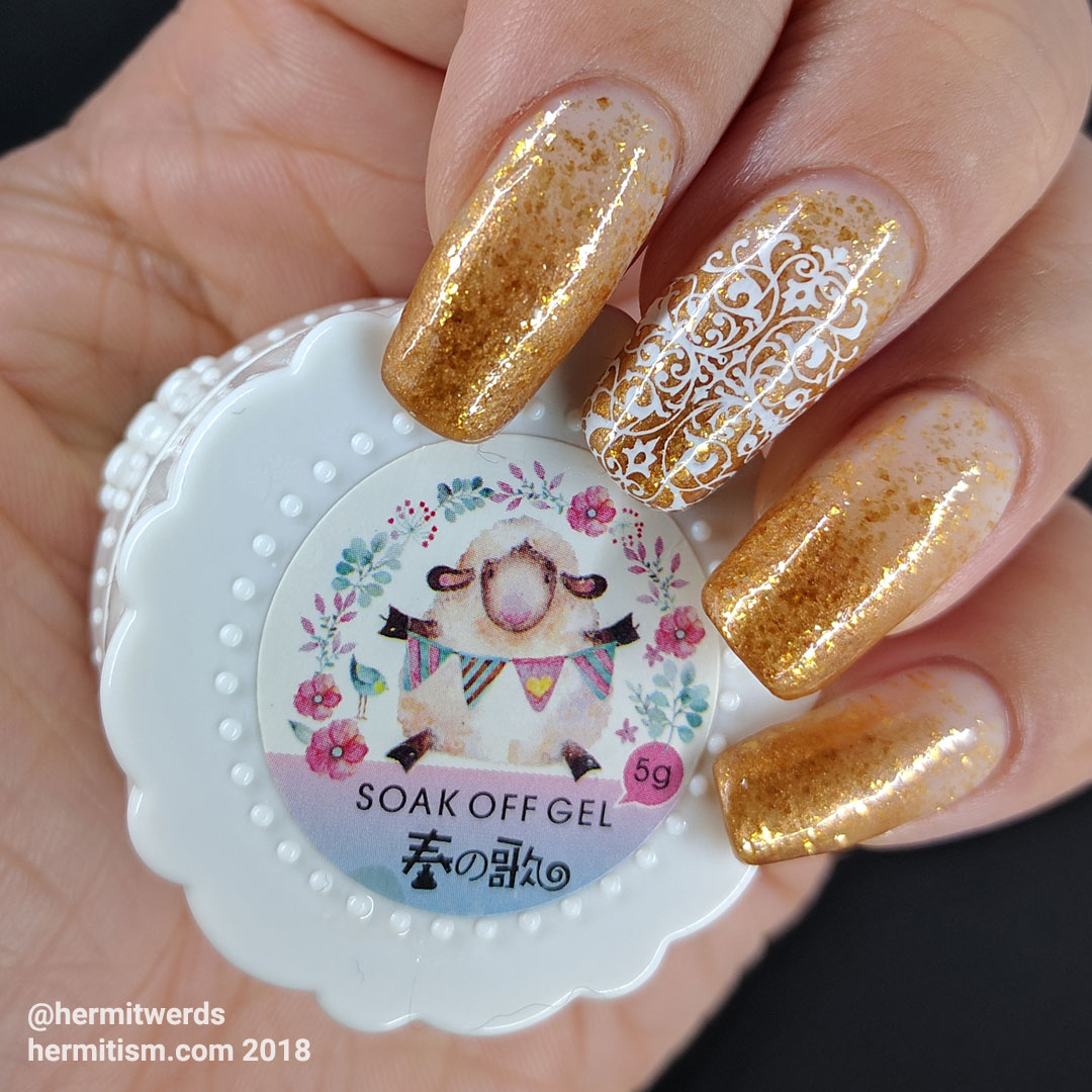 Golden for Office - Hermit Werds - glittery gold baby boomer french tip with a lacy accent nail