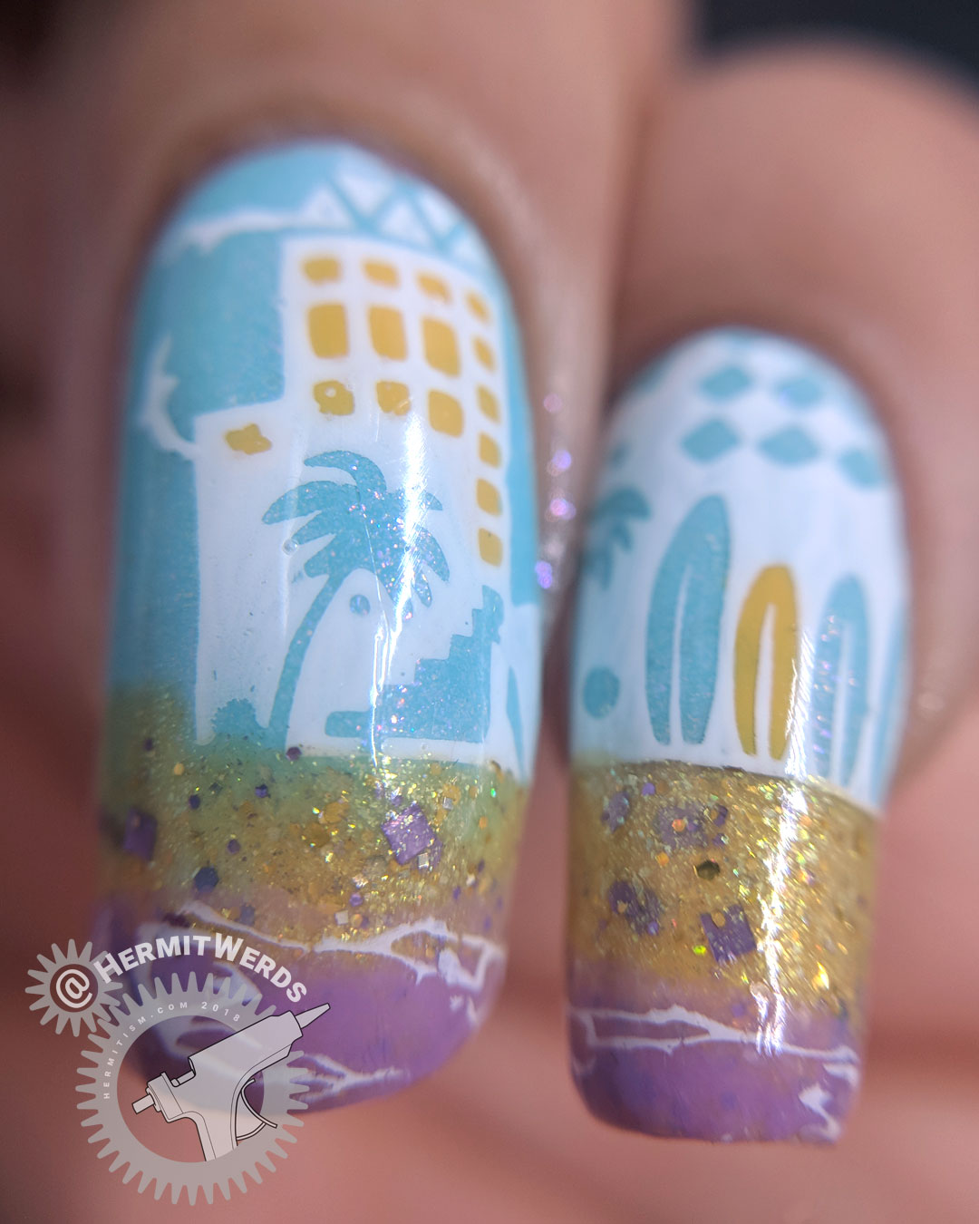 Day at the Beach 2.0 - Hermit Werds - nail art of a lilac ocean and glittery sand with waves, sandcastle, and beach-y city.
