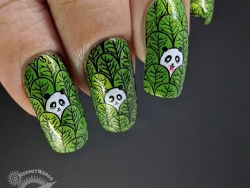 Panda Birthday - Hermit Werds - nail art of pandas peeking out of a forest of leaves, on is a vampire!