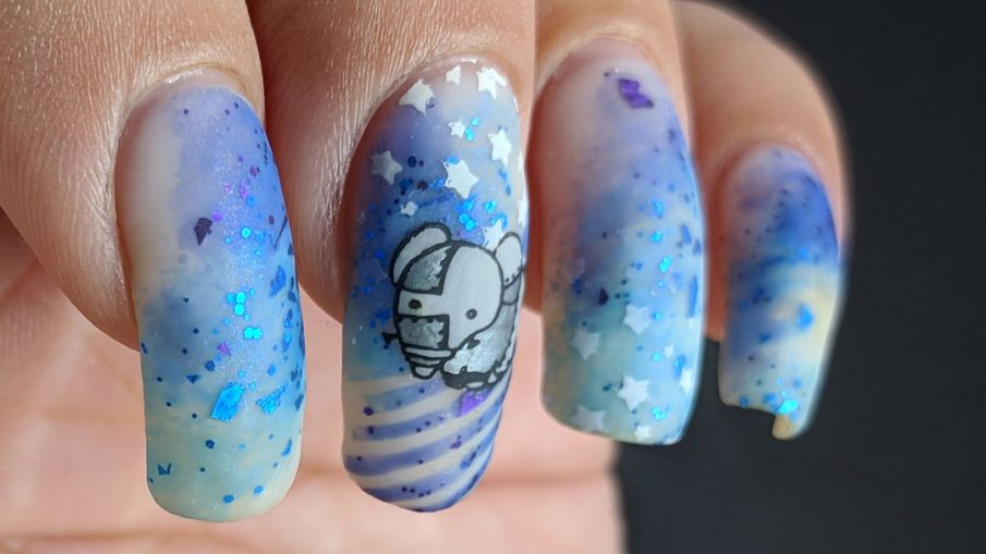 The Robots Remain - Hermit Werds - nail art of little robots against a galactic sky of stars