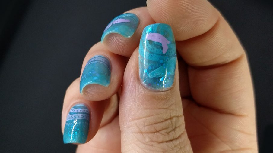 Jelly Depths - Hermit Werds - underwater nail art with a bright blue jelly polish, lavender waves, and stamps of squid, a sea turtle, and a whale