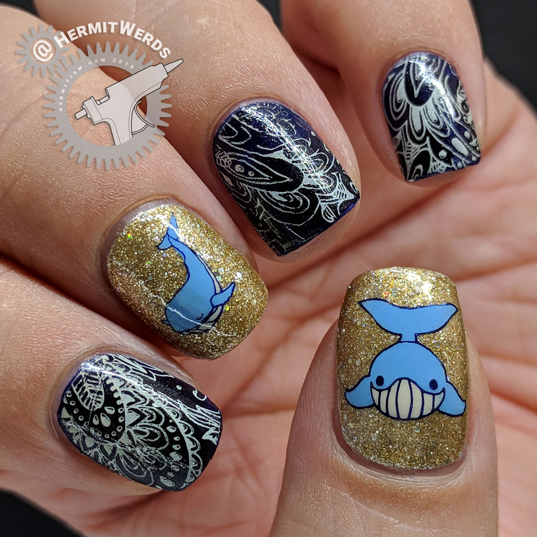 Paisley Whale - Hermit Werds - nail art with a dark blue and cream paisley pattern and two glittery gold whale accent nails