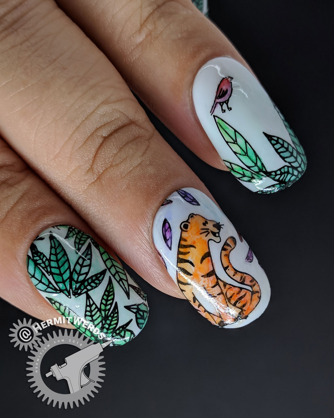 Tiger Munchies - Hermit Werds - nail art of watercolor tiger gazing hungrily at a little bird in the jungle