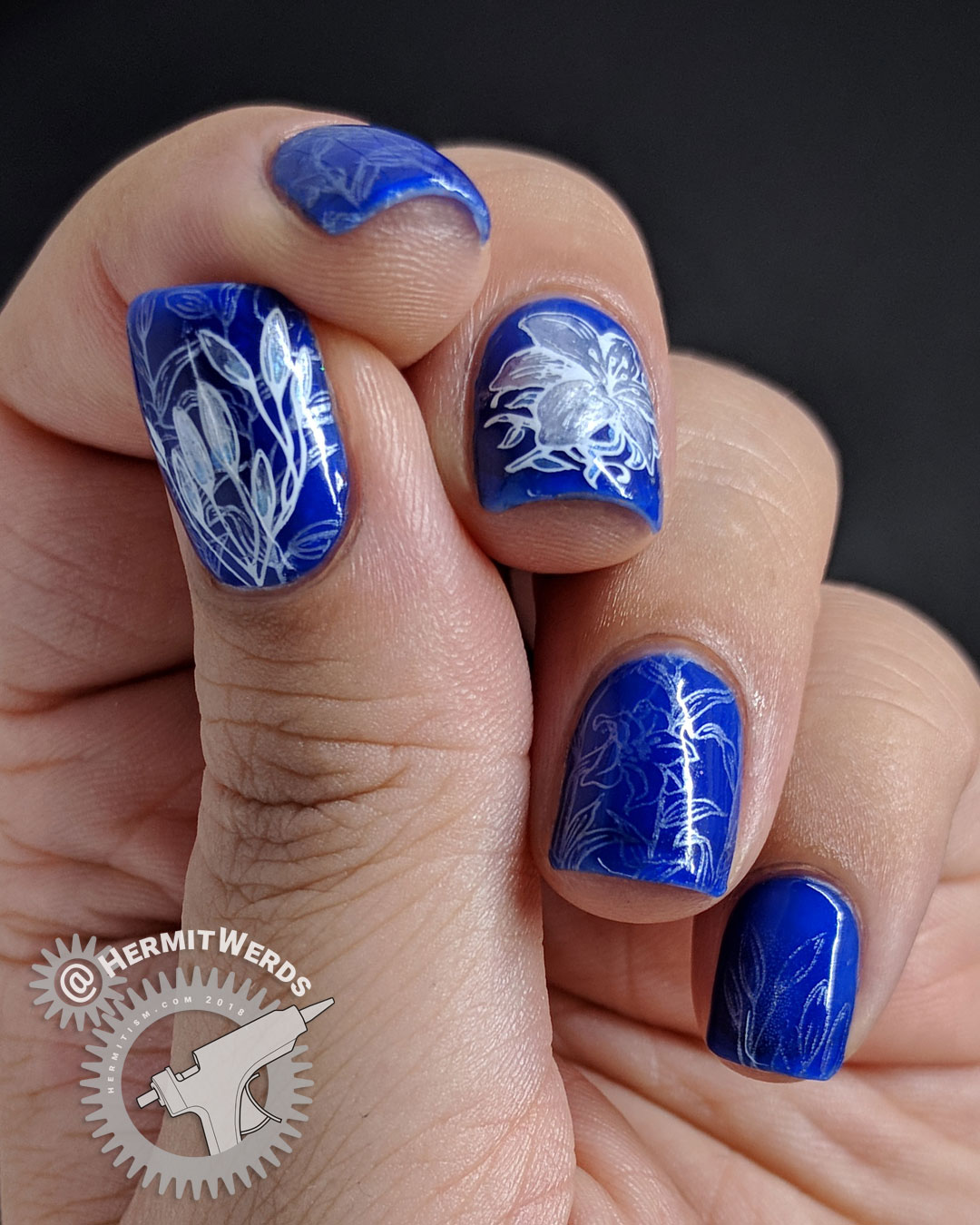 Blue Lily - Hermit Werds - cobalt blue nail art with pearly white lily nail stamping and flower decal
