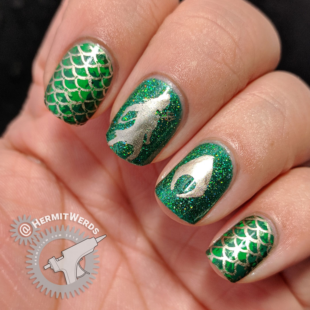 DC Heros - Aquaman - Hermit Werds - green, scale-y, and trident-y nail art for DC's Aquaman with holographic glitter on top.