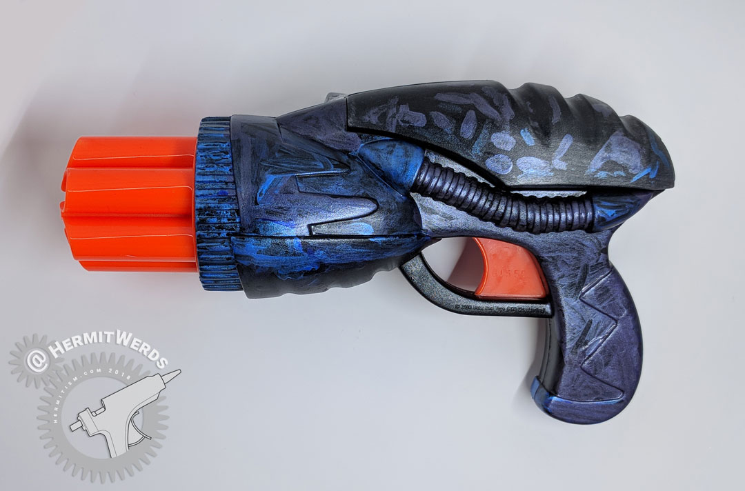 Dart Gun Mod - reassembled - Hermit Werds - reassembled dart gun painted with black and metallic purple and blue