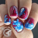 Lady of the Bees 2.0 - Hermit Werds - blue bee fairy stamping decal and lilies on a red to pink fluid art base.