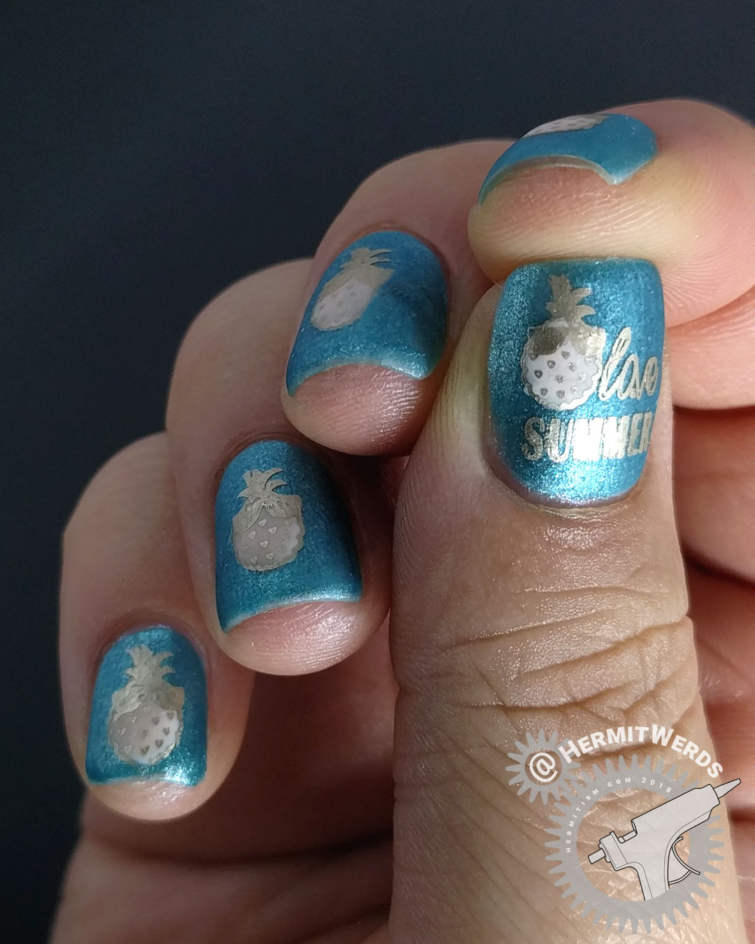 Pink Pineapple - Hermit Werds - matte nail art with pink pineapples on a sparkly blue-green background