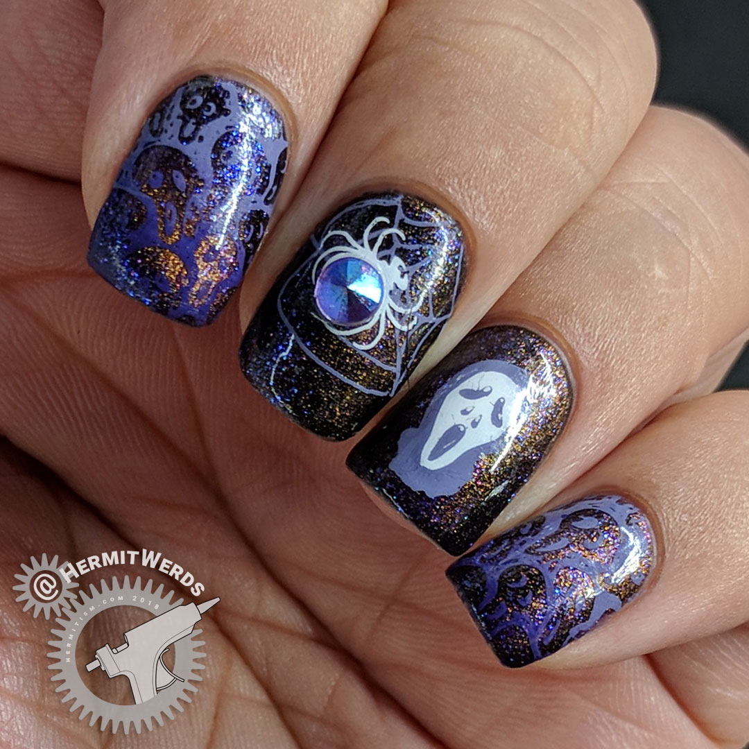 Thankfully Halloween - Hermit Werds - purple magnetic polish with spooky stamping (spider, ghouls, bats, haunted house) on top
