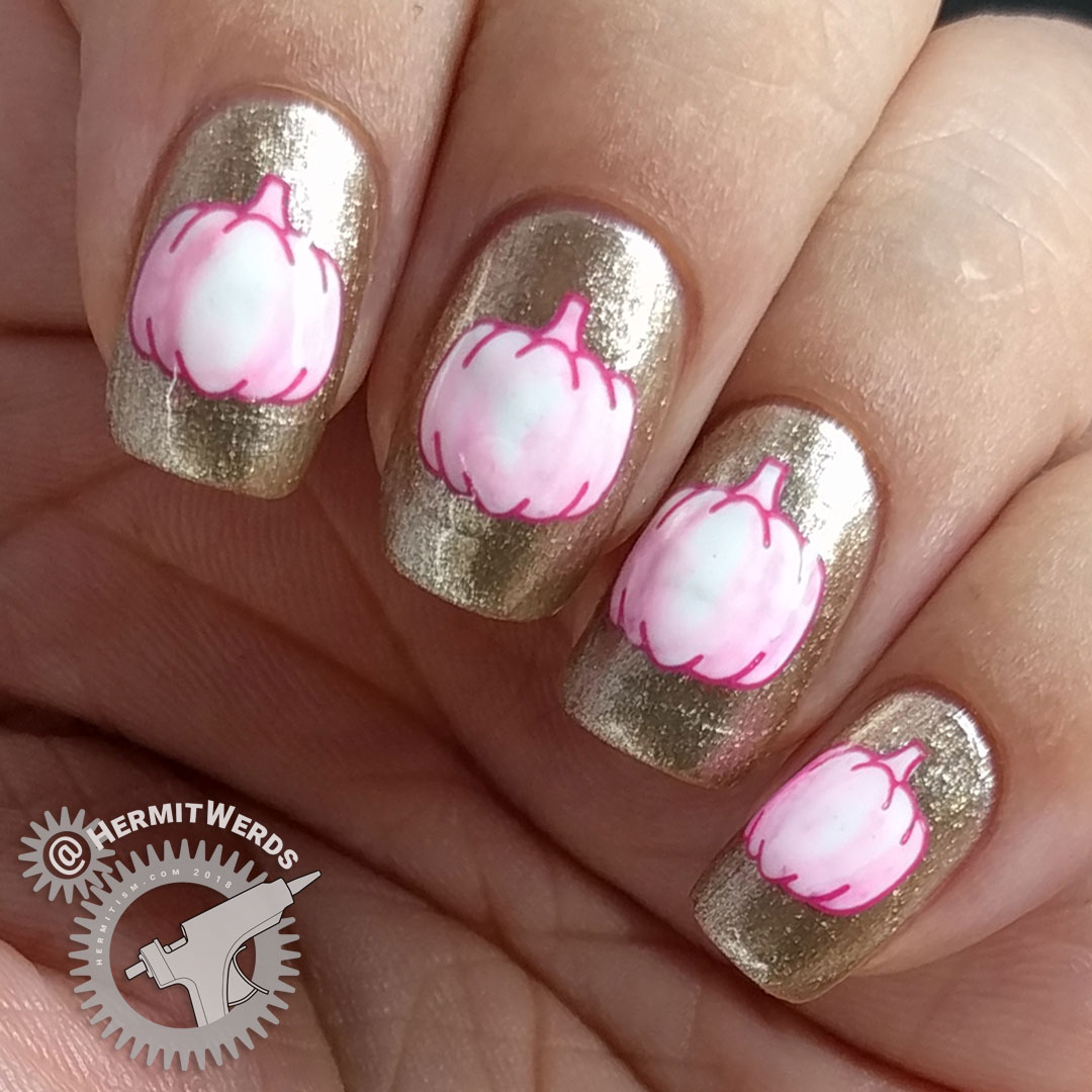 Glam-kin - Hermit Werds - nail art of a white pumpkin stamping tinted a little bit pink on a glitzy golden background