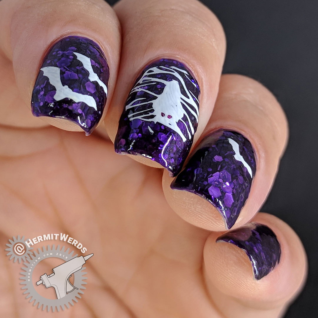 Going Batty - Hermit Werds - purple glitter-filled jelly nails with white bat nail stamping on top