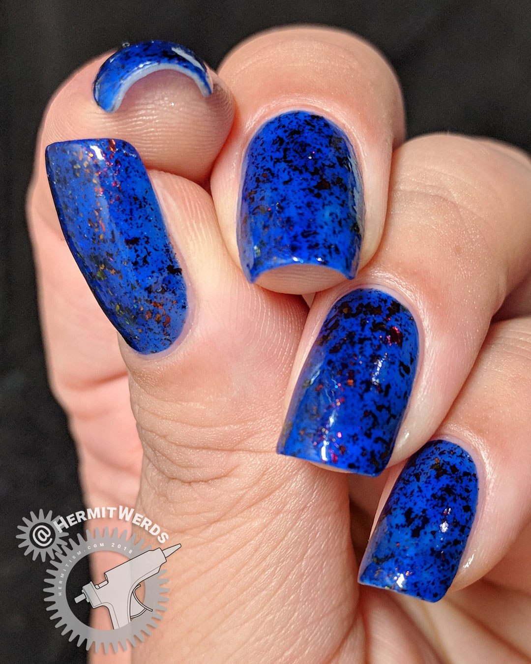 "Ms Sparkle's ""Oh So Nifty!"" - Hermit Werds - swatch of deep ultramarine jelly with orange/green/yellow/gold chameleon flakies"