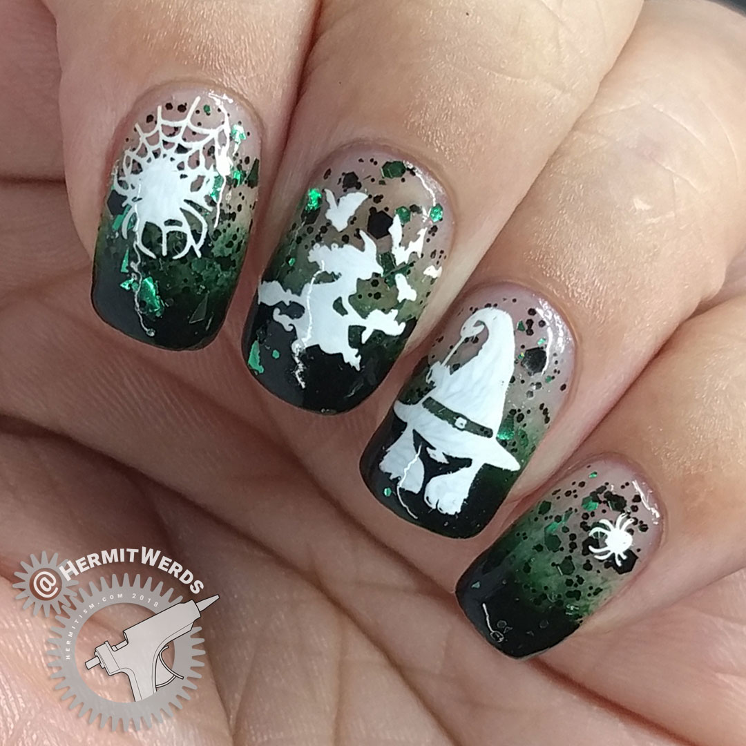 Witch of Spiders - Hermit Werds- dark green baby boomer french tips with black and green glitter and white witch and spider stamping on top