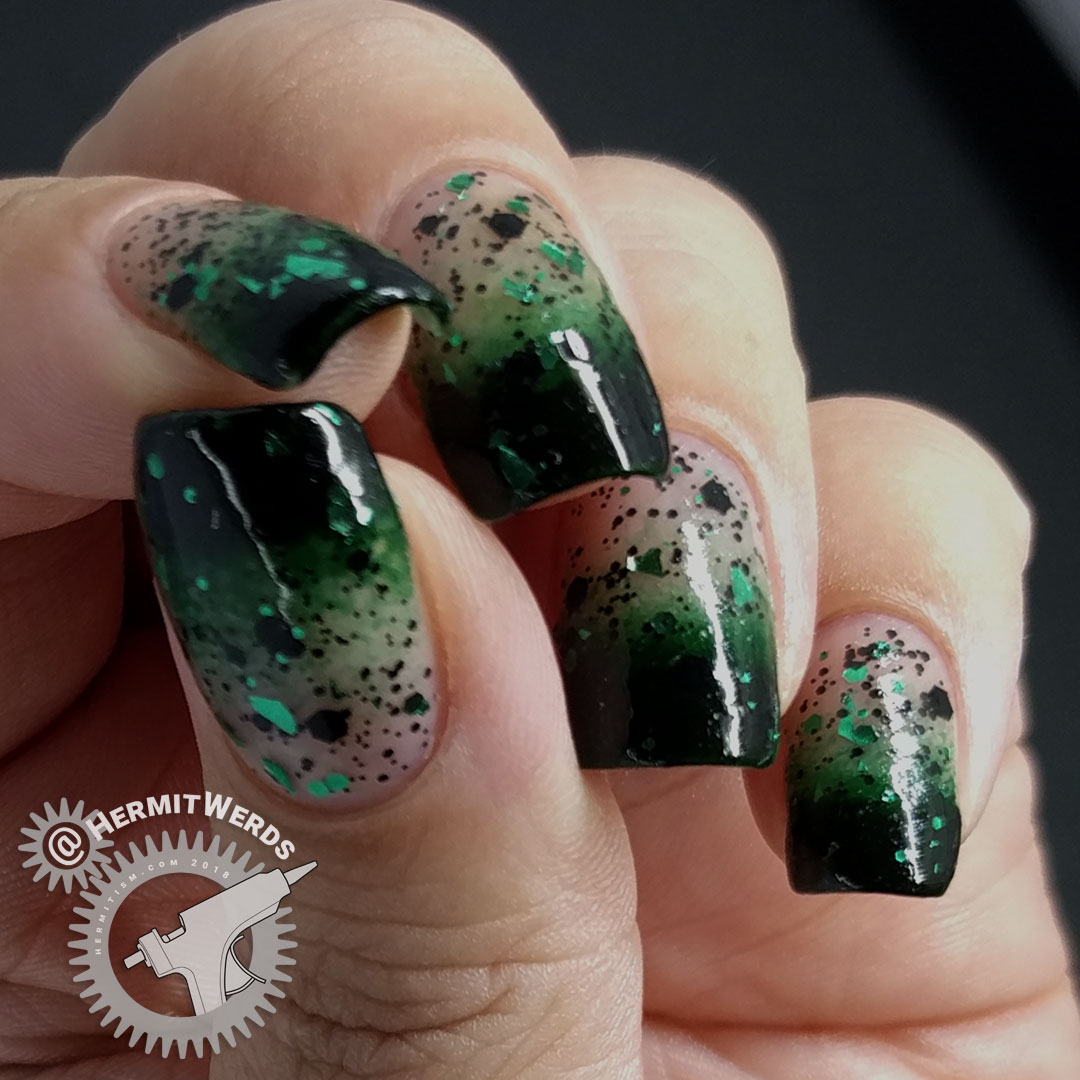 Glittery Green Baby Boomer French Tip - Hermit Werds - dark green baby boomer french tips with shards of black and green glitter on top