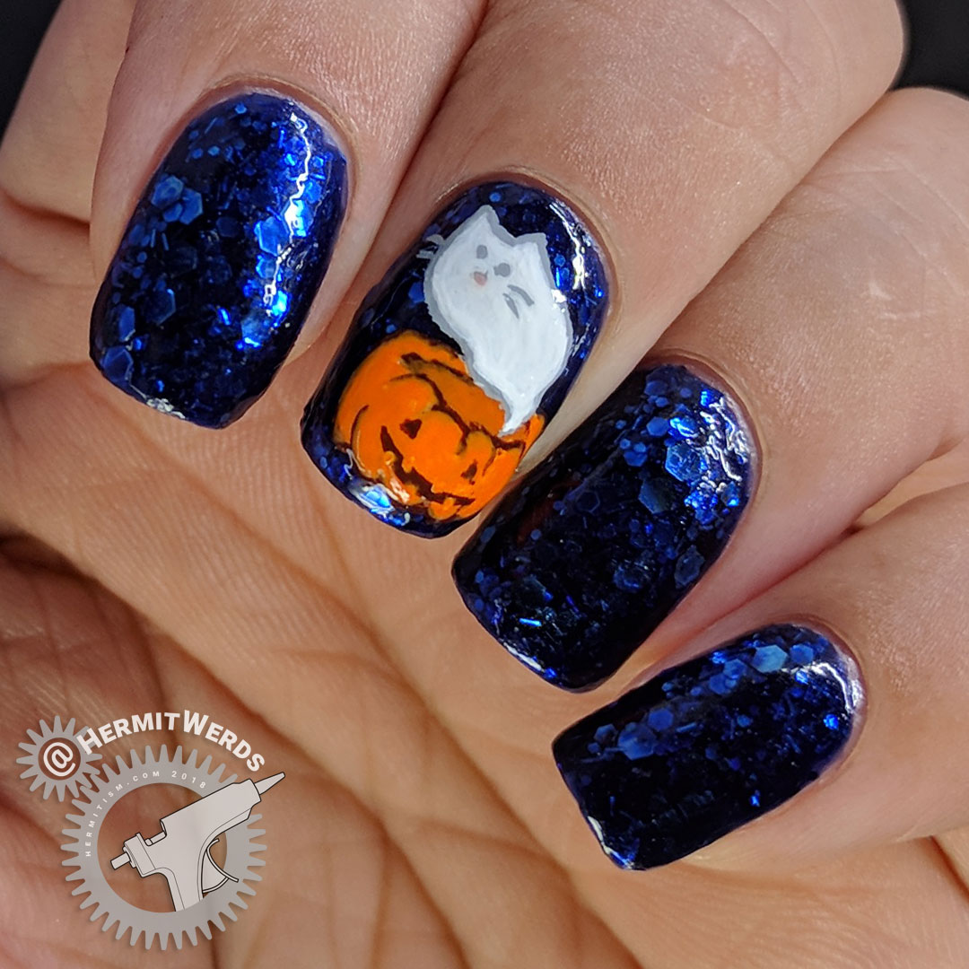 Spooky Pusheen - Hermit Werds - a Pusheen ghost emerging from a jack-o-lantern freehand painted on a royal blue glitter-y jelly base