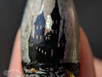 Tomb of Snow White - Hermit Werds - horror-themed Snow White nails featuring skeleton of Snow White and her funeral flowers on a grey and black nail art with rose to green to gold flakies and shimmer