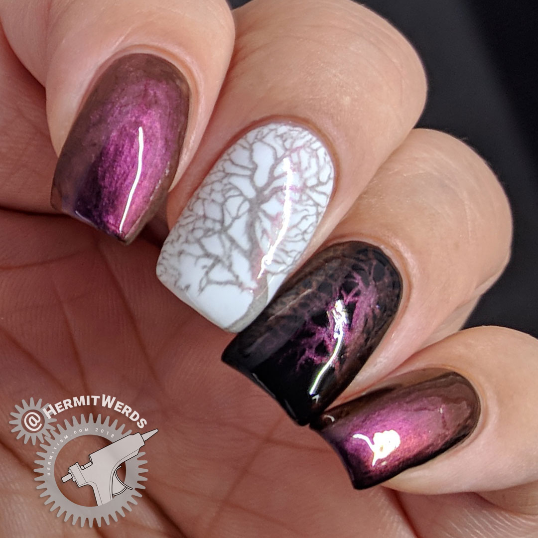 BeautyBigBang Duochrome Swatch J6504TM-2A - Hermit Werds - magenta to purple to red duochrome stamping swatch on natural nail, white, and black