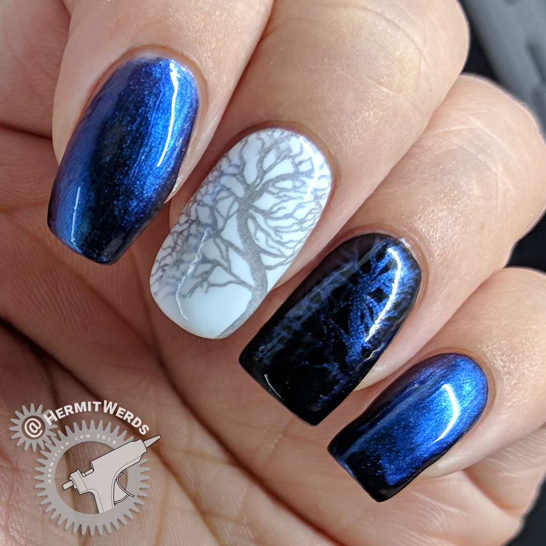 BeautyBigBang Duochrome Swatch J6504TM-5A - Hermit Werds - blue to purple duochrome stamping swatch on natural nail, white, and black