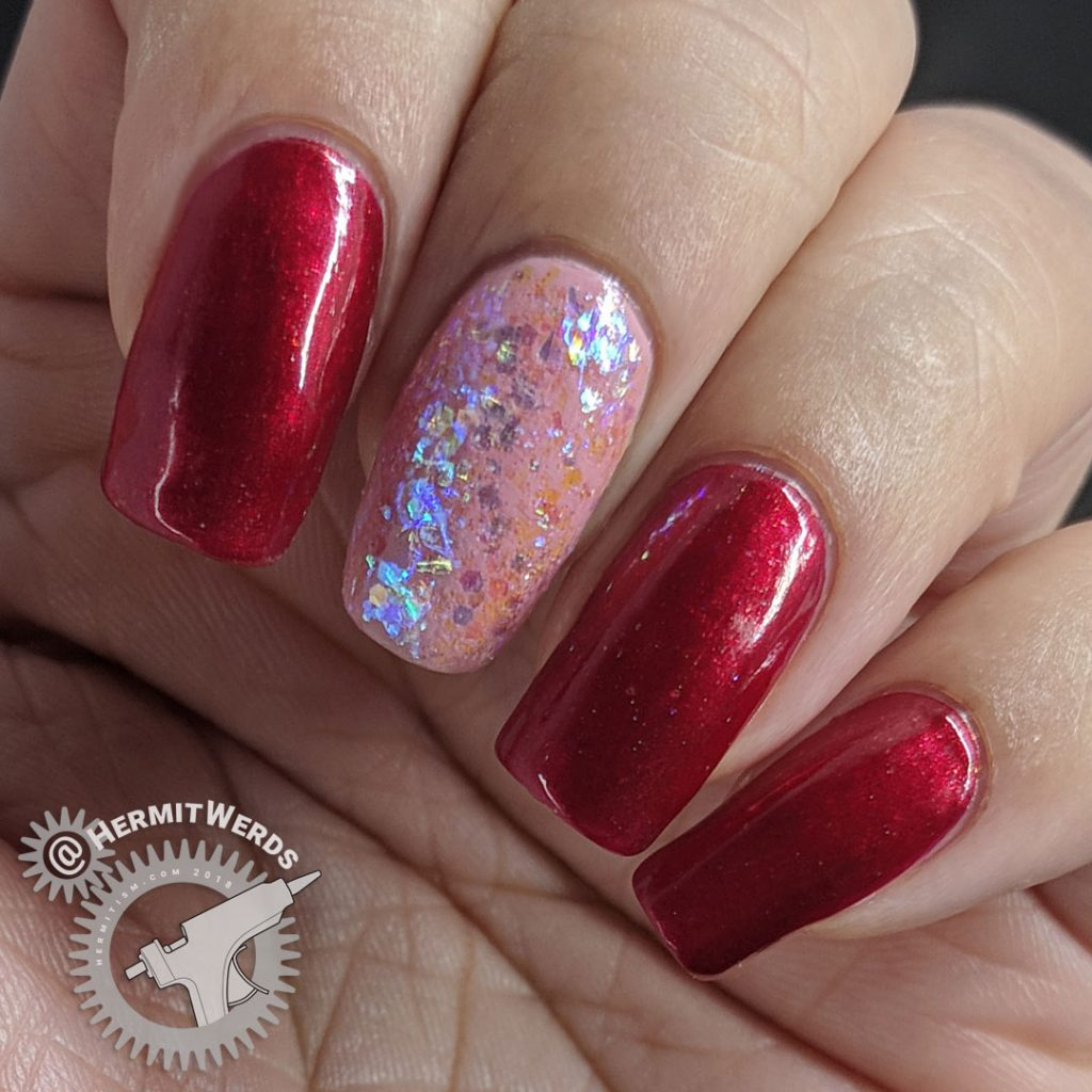Red & Pink Base - Hermit Werds - red manicure with a pink accent nail covered with iridescent glitter