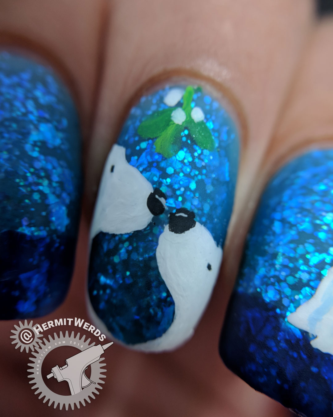 "Sinful Colors' ""Bangin' Blue"" - Hermit Werds - freehand nail art of two polar bears about to kiss beneath the mistletoe on a blue jelly polish full of iridescent glitter with icebergs decorating the other nails"
