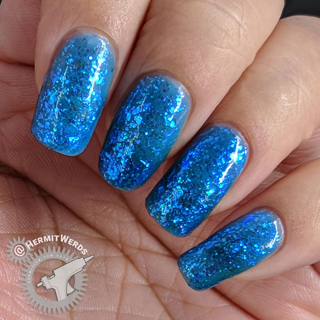 "Sinful Colors' ""Bangin' Blue"" - Hermit Werds- nail swatch of bright blue jelly with iridescent glitter"