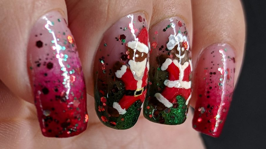Santa Cookie - Hermit Werds - glittery red and green baby boomer french tip nails decorated with gingerbread Santa, Mrs. Clause, and Rudolph cookies