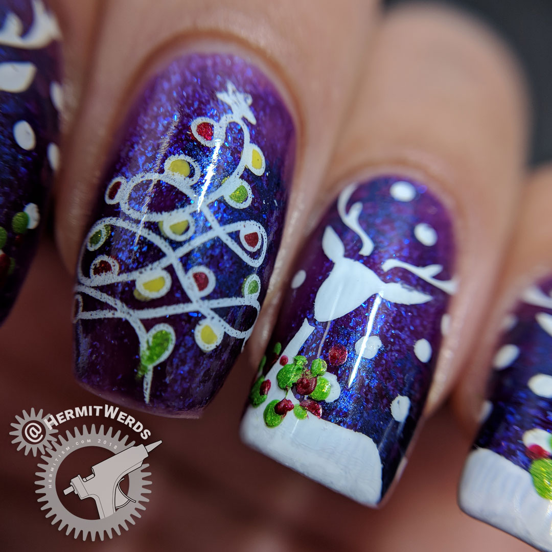 Vixen's Tree of Lights - Hermit Werds - nail art featuring reindeer wearing festive Christmas wreathes and a Christmas tree made of string lights on a shimmery purple and blue background
