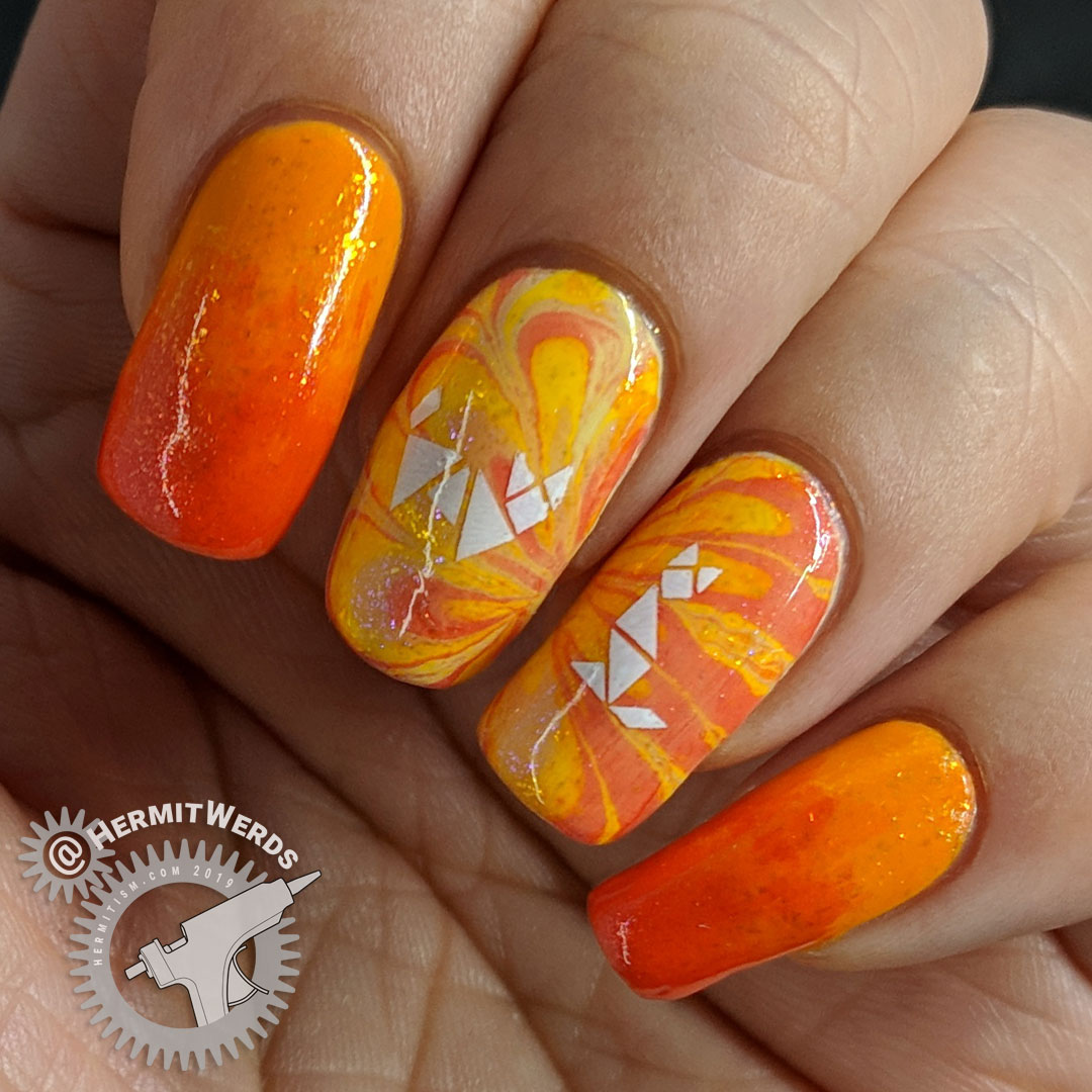 Kitty Tangrams - Hermit Werds - sparkly orange water marble nail art with two white cat tangram puzzles stamped on top