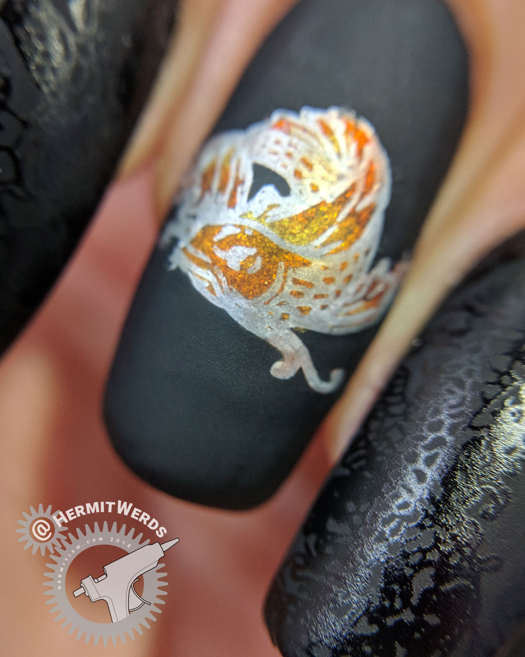 The Fishery - Hermit Werds - matte black nail art with a golden koi fish and glossy stamping
