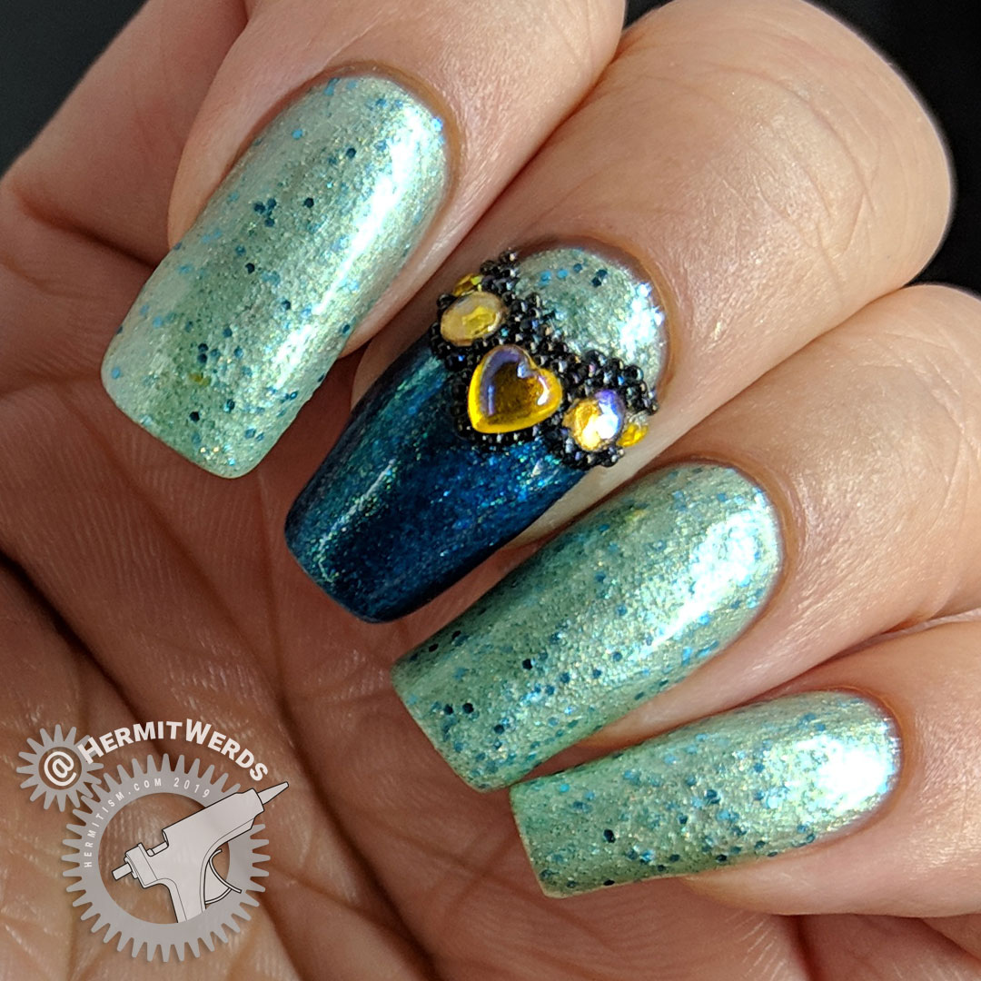 Bejeweled Mint - Hermit Werds - glittery mint mani with bejeweled accent nail covered in yellow rhinestones and black caviar beads