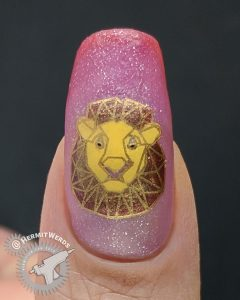 Geometric Lion - Hermit Werds - nail art with geometric lion stamping decals on an orange/magenta/red thermal/solar polish with a dark gold accent nail