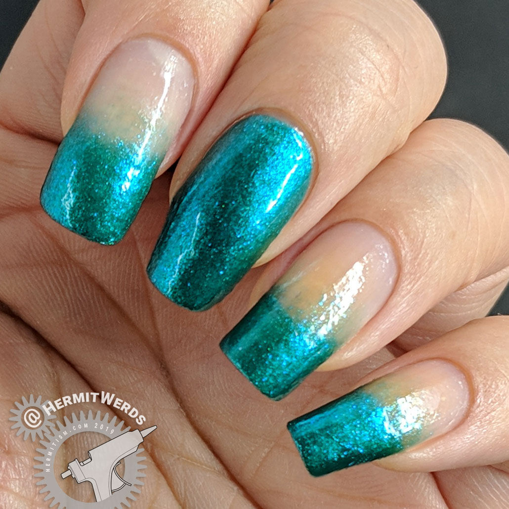 "Sinful Shine's ""Kryptonite"" Swatch - Hermit Werds - metallic teal baby boomer french tips"