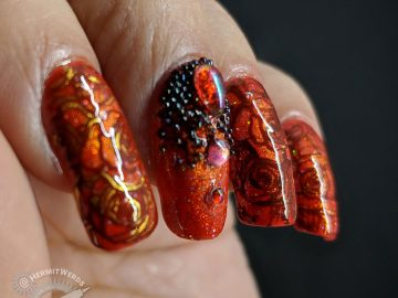 Magnetic Roses - Hermit Werds - magnetic orange gel polish with glitter nail art with rose stamping and orange AB rhinestones and black caviar beads
