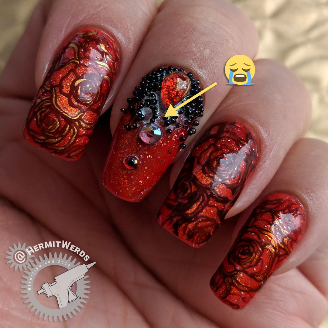 Magnetic Roses (glue fail) - Hermit Werds - magnetic orange gel polish with glitter nail art with rose stamping and orange AB rhinestones and black caviar beads