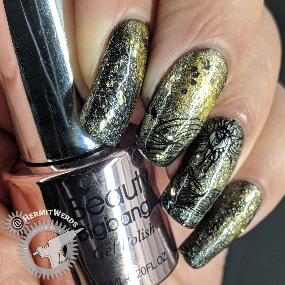 """Magnetic Sol - Hermit Werds - nail art featuring a sun-baked landscape on a magnetic khaki background with a golden scatter of glitter """"stars"""""""
