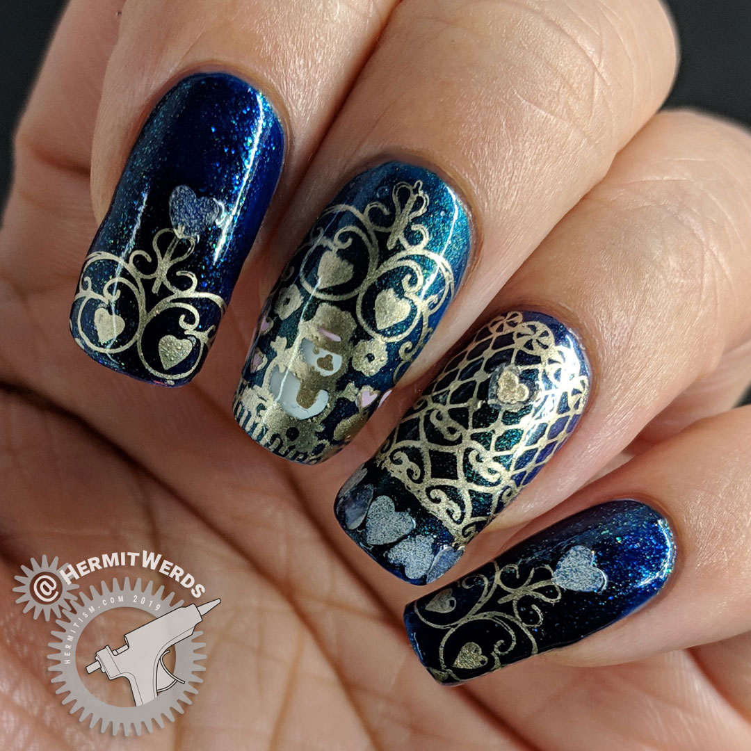 Winter's Love - Hermit Werds - blue chameleon nail art with golden lace, snowman, and hearts including glow in the dark hearts