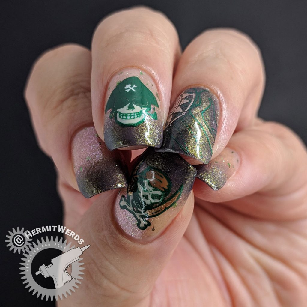 Brown and green skeletal pirate nail art with map and compass.