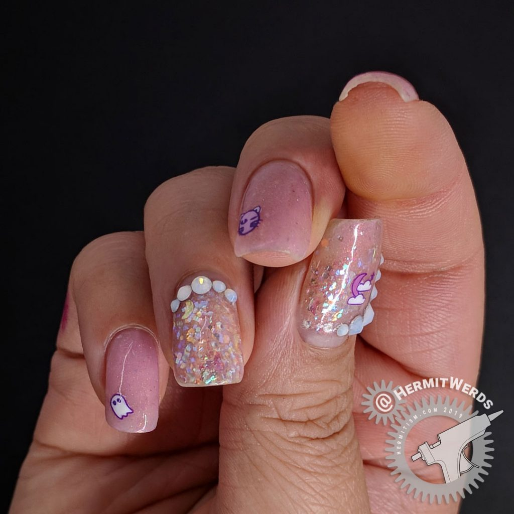 Delicate pink nail art with cute Halloween icons and opal glitters and rhinestones.