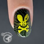 Olive green nail with creepy pattern and ocre pirate rabbit.
